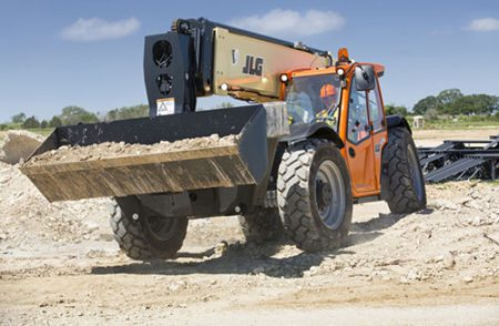 JLG 1255 moving rocks